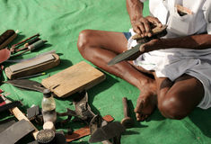 Indian Cobbler make handmade shoe Royalty Free Stock Photo