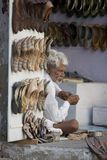 Indian Cobbler. MANDAWA, INDIA - 17 OCTOBER 2013 - Unidentified typical indian shoemaker in a the market of the ancient town of Mandawa, Rajasthan royalty free stock images