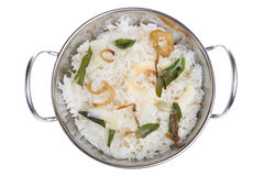 Indian Coconut Rice. Delicately flavoured coconut rice with fried onions and curry leaves Royalty Free Stock Photos