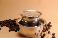 Indian coffee. With beans background Royalty Free Stock Images