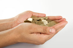 Indian coin collection in hand. Pile of money (indian coin ) in hand isolated on white background Royalty Free Stock Images