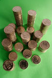 Indian coins. Stack of indian coins on green Stock Photos