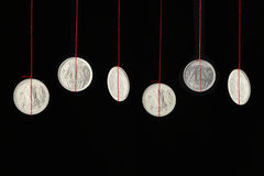 Indian coins hanging on strings Stock Photography