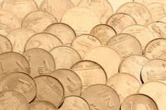 Indian coins. A pile of Indian coins irregularly arranged background Stock Photos