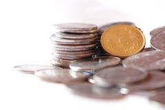 Indian coins. With 5 rupee coin in focus Royalty Free Stock Photo