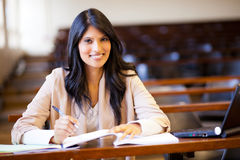 Indian college girl. Beautiful female indian college girl in lecture hall Stock Image