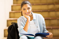Indian college girl sitting on stairs Royalty Free Stock Photos