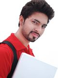 Indian College Student over white background. Closeup / Portrait of a young Indian / Asian Male College Student holding laptop computer, on isolated white Royalty Free Stock Photo