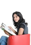 Indian college student reading book. Royalty Free Stock Photography