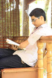 Indian College Student Reading Textbook Royalty Free Stock Photo
