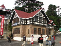 Indian colonial house. Traditional colonial house on Mall Road in Shimla with people walking in the foreground, Himachal Pradesh, India Royalty Free Stock Photos
