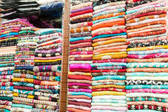Indian colorful dresses on the shelves. Indian colored clothes on the shelves of a store in Dubai Royalty Free Stock Image