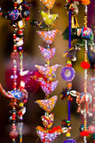 Indian colors, home ornamentation. Close up photo of bright warm colorful Indian home  decorations: different shapes, wonderful national patterns (flowers Stock Images