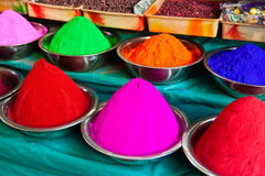 Indian coloured powders. Colors (Kumkum) for tilaka and bindi dots on the market in Mysore in India Stock Photos