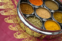 Indian Cookery Spices in Silver Pots on Pink Saree Stock Photo