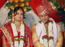 Indian couple. An traditional hindu indian couple posing for photograph in their wedding Stock Photos