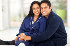 Indian couple bedroom. Beautiful loving indian couple sitting in bedroom Royalty Free Stock Image
