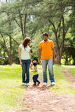 Indian couple boy. Cute young indian couple with baby boy walking outdoors Royalty Free Stock Photo