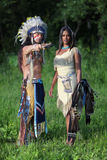 Indian couple. Indian chief with a young Indian on the green meadow stock photo