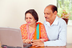Indian couple on computer Stock Image