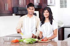 Indian couple cooking Royalty Free Stock Image