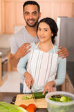 Indian couple cooking together Stock Images