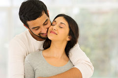 Indian couple embracing. Loving young indian couple embracing at home Stock Images