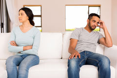 Indian couple having conflict. Angry indian couple having conflict at home Stock Photos