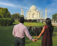 Indian Couple holding hands in love with beautiful Tajmahal Agra. Love. Valentine.
