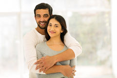 Indian couple hugging. Romantic indian couple hugging at home royalty free stock image