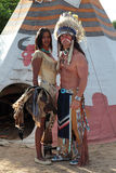 Indian couple. Indians men and women stand against the background of teepee royalty free stock photos