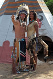 Indian couple. Indians men and women stand against the background of teepee royalty free stock image