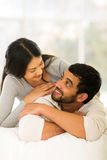 Indian couple lying Stock Images