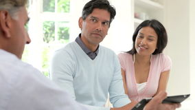 Indian Couple Meeting With Financial Advisor At Home stock footage