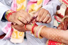 Indian couple playing Ring Fishing game in wedding stock images