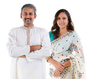 Indian couple. Portrait of mid age beautiful Indian family in traditional costume standing isolated on white background. Indian husband and wife model Royalty Free Stock Images