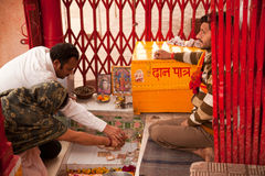 Indian couple praying inside temple Stock Photography