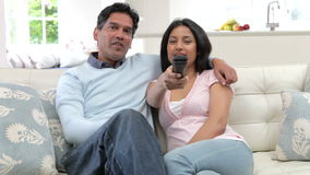 Indian Couple Sitting On Sofa Watching TV Together stock footage