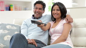 Indian Couple Sitting On Sofa Watching TV Together stock video footage