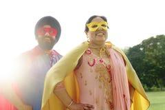 Indian Couple Superheroes Love Concept Stock Photo
