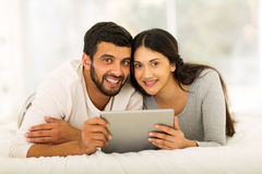 Indian couple tablet computer. Beautiful indian couple using tablet computer at home Royalty Free Stock Photo