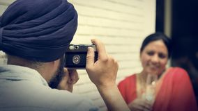 Indian Couple Taking Pictures Concept Stock Photography