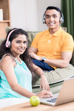 Indian couple in their living room using computer royalty free stock photography