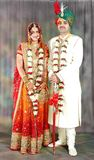 Indian couple in their wedding dress. Beautiful Indian couple on their wedding day in their traditional dress Royalty Free Stock Photos