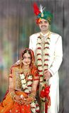 Indian couple in their wedding dress. Beautiful Indian couple on their wedding day in their traditional dress Stock Images