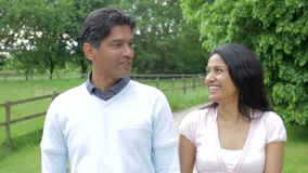 Indian Couple Walking In Countryside Royalty Free Stock Images