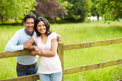 Indian Couple Walking In Countryside. In Daylight Looking To Camera Smiling Stock Photo