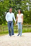 Indian Couple Walking In Countryside Stock Image
