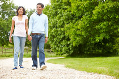 Indian Couple Walking In Countryside Royalty Free Stock Photo