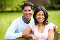 Indian Couple Walking In Countryside. Leaning On Fence Smiling Royalty Free Stock Photos